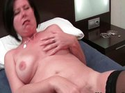 Mature with big tits plays with vibrator