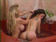 Blond lesbian babe bathtub treating her partner