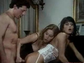 These two retro MILFs share one cock
